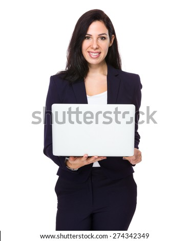 Brunette Businesswoman use of laptop