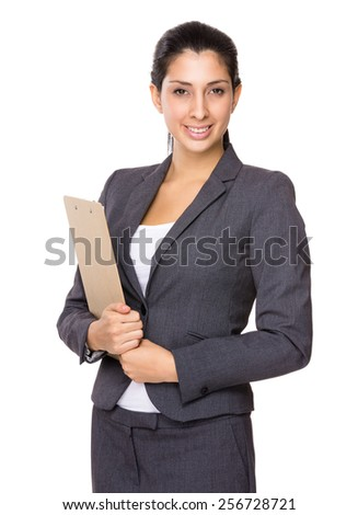 Brunette Businesswoman with clipboard - stock photo