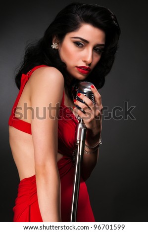 Brunette chanteuse in a vintage red dress