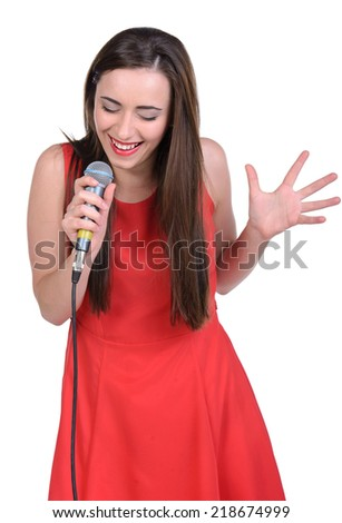 Brunette chanteuse in a vintage red dress. Isolated over white background. - stock photo