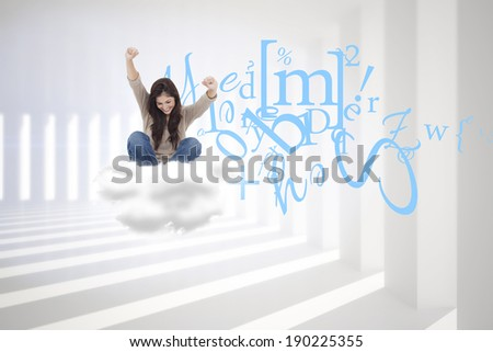Brunette cheering while using laptop against curved white room - stock photo