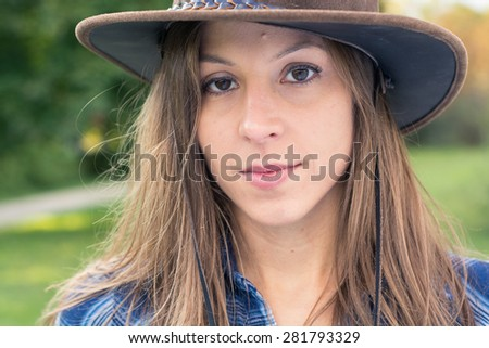 Brunette cowgirl posing on farm