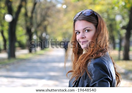 brunette Cute young woman posing outdoors in nature