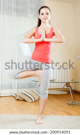 Brunette doing physical exercises at home