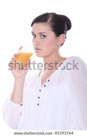 Brunette drinking orange juice - stock photo