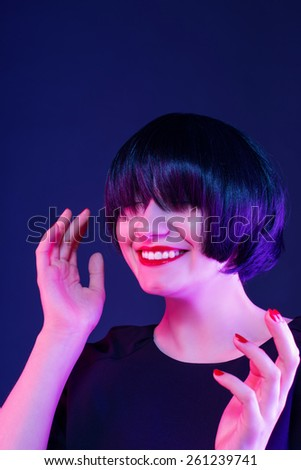 brunette enjoys. photo taken in studio - stock photo
