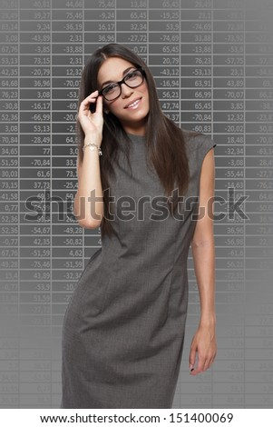 Brunette financial analyst with numbers - stock photo