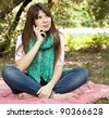 Brunette girl at outdoor colling by phone. Autumn. - stock photo