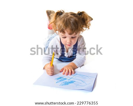 Brunette girl drawing on the floor - stock photo