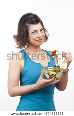 brunette girl eating salad