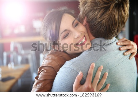 Brunette girl happy to see her boyfriend again - stock photo
