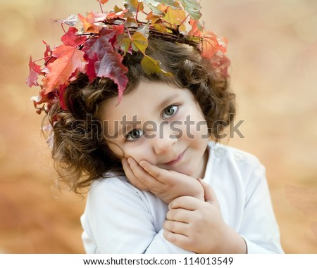 brunette girl in a autumn crown - stock photo