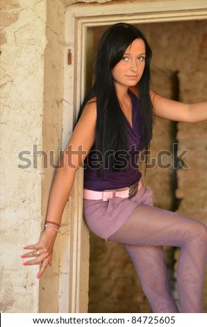 brunette girl in window - stock photo