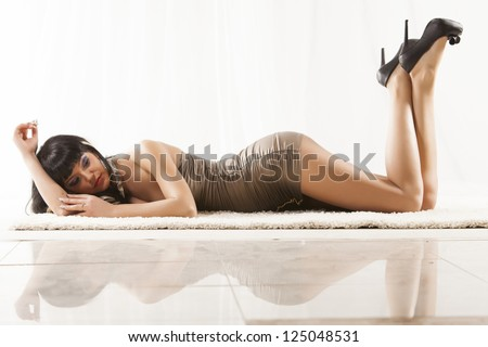 Brunette girl laying on the flor - stock photo