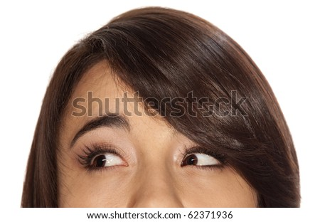 Brunette girl looking to her right, showing only her eyes. - stock photo