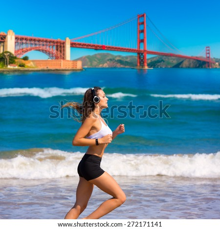 Brunette girl running on the beach San Francisco Golden Gate bridge photo mount - stock photo