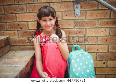 Brunette girl seated on stairs in the city - stock photo