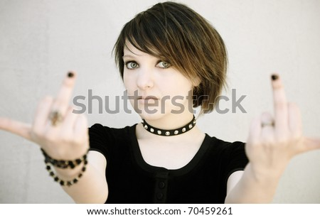 brunette girl showing middle finger - stock photo