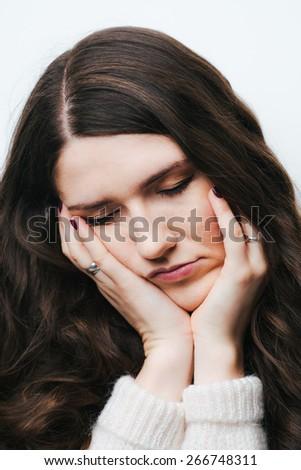 brunette girl tired on a white background - stock photo