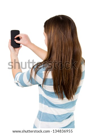 Brunette Girl using touchscreen of a Smartphone - stock photo