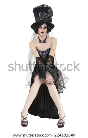 Brunette girl wearing a Mad Hatter black halloween party costume on white - stock photo