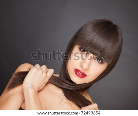 Brunette girl with healthy hair, horizontal studio isolated shot - stock photo