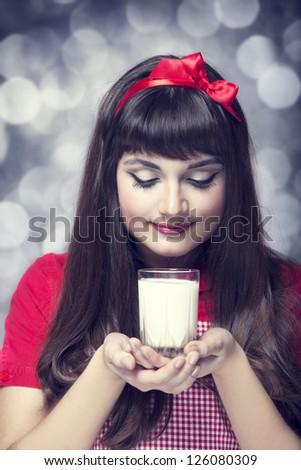 Brunette housewife wih milk - stock photo