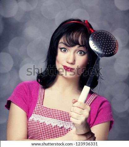 Brunette housewife with soup ladle - stock photo