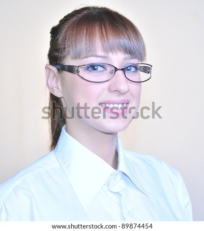 Brunette in glasses ready to help you.