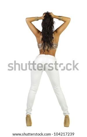 Brunette in White Jeans and Midriff Top - stock photo