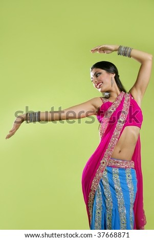 Brunette indian dancer princess Bollywood style, colorful sari - stock photo