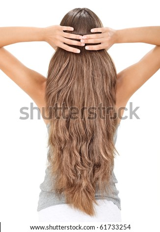 Brunette lady holding long hairs, view from back side isolated on white - stock photo