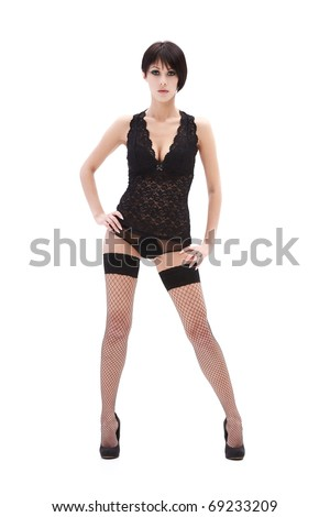 Brunette lady in black lingerie isolated on white background - stock photo
