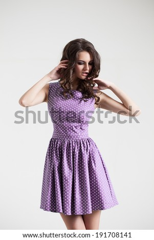 brunette lady in color dress. Fashion portrait in studio. Sexy beautyful dress - stock photo