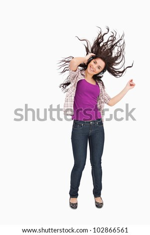 Brunette listening to music with her hair in the hair against white background
