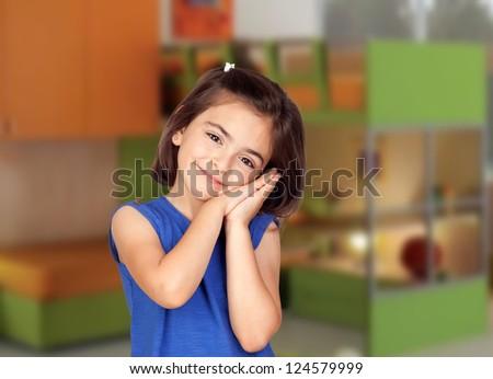Brunette little girl in her bedroom - stock photo