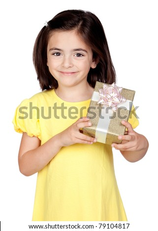 Brunette little girl with a gift isolated on a over white background - stock photo