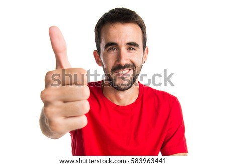 Brunette man with thumb up