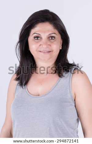 Brunette middle age asian woman with gray singlet smiling half body shot - stock photo