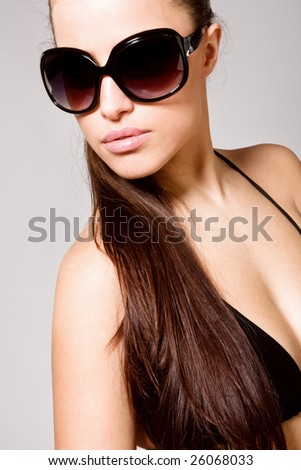 brunette model portrait with sunglasses - stock photo
