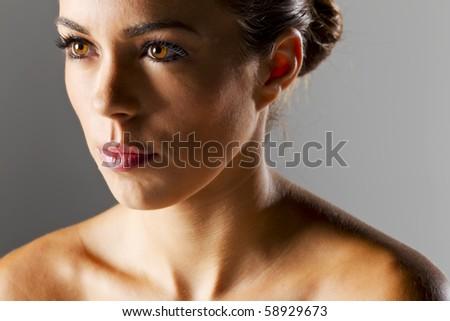 Brunette model wearing a black dress in a studio environment - stock photo