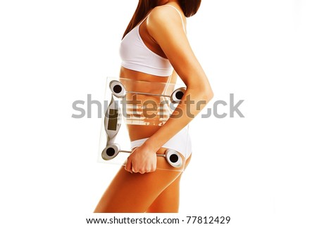Brunette model with scales in hand on white background - stock photo