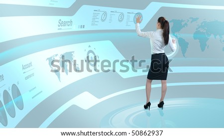 Brunette operating search interface on the wall (Attractive young adults in futuristic interfaces / interiors series) - stock photo