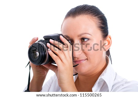 Brunette photographer woman holding camera over white background