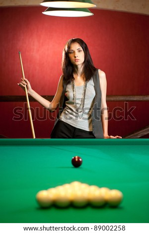 Brunette playing snooker - stock photo