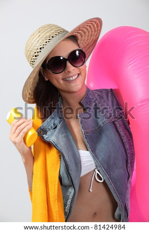 Brunette ready for the beach - stock photo