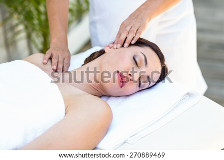 Brunette receiving neck massage at the spa - stock photo