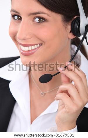 Brunette receptionist wearing head-set - stock photo
