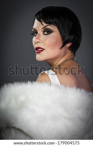 Brunette, Retro posing lady,  flapper dress, Girl dreaming beautiful young woman from roaring 20s looking at camera.  vintage twenties - stock photo
