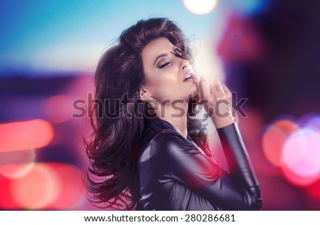 brunette seductress in lights